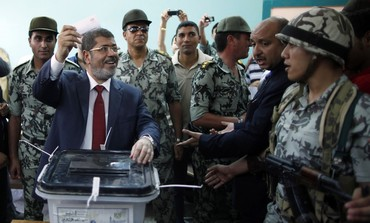 Muslim Brotherhood candidate Mohamed Mursi  votes