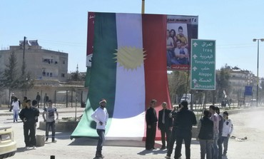 Kurds erect large Kurdistan flag in Syria protest
