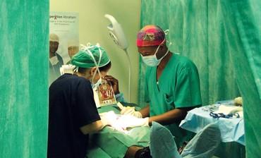 Doctors perform circumcision