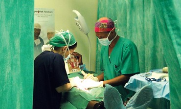 Doctors perform circumcision