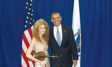 Miri Ben-Ari poses with US President Barack Obama