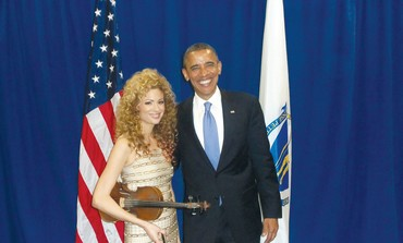 Miri Ben-Ari poses with US President Barack Obama