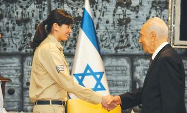 PERES greets St.-Sgt. Hagar Zohar