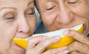 Elderly couple eating fruit [illustrative]