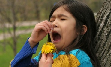 A young girl with allergies