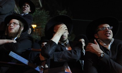A haredi man overcome with grief