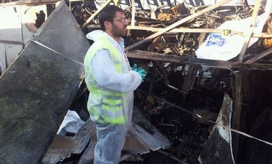 ZAKA man examines damage in Burgas