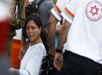Israeli survivor is carried on a wheelchair after burgas bomb