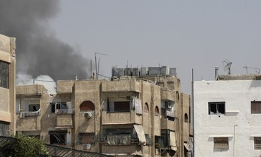 Smoke is seen rising over Damascus