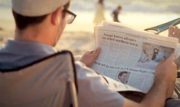 MAN reads a copy of 'The Jerusalem Post'