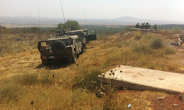 ISRAELI SOLDIERS keep watch over the Syrian border
