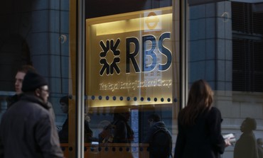 People walk past a Royal Bank of Scotland (RBS)