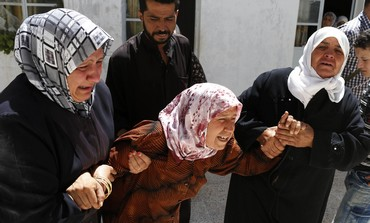 Mother of Amar Ali Amero at his funeral in Azaz