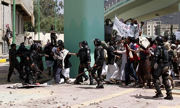 Police, protesters near US embassy in Yemen
