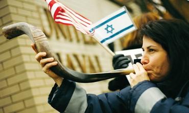 Woman blows shofar
