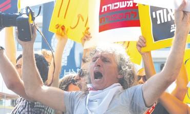 YOSSI ALONI, a veteran 'Ma'ariv' photojournalist