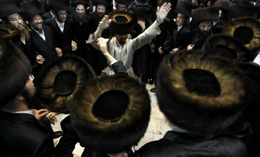 Haredi men dance on Simhat Torah