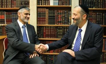Shas's Arye Deri, Eli Yishai shake hands