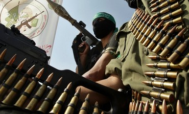 Hamas members take part in a rally