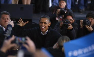 Obama greets supporters during a campaign rally