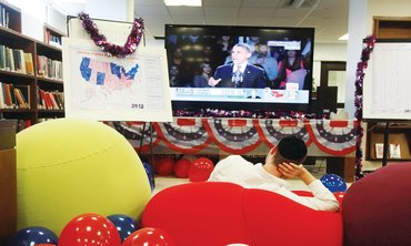 Man watches US election results in party in Jlem.