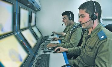 MAJ. ITAMAR ABU (right) commands TA Iron Dome
