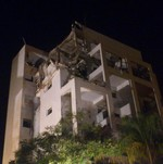 Building hit by rocket in Rishon Letzion