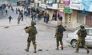 IDF troops disperse Palestinians in Hebron [file]