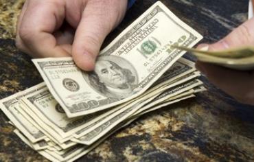 Dollar bills.
