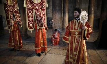 Members of the Greek Orthodox clergy and altar ser