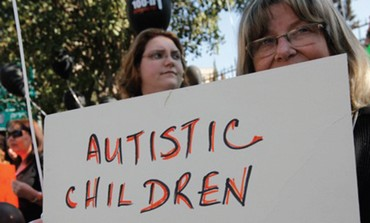 Parents demonstrate for autistic children
