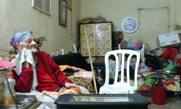 Eldery woman in her house in Argazim neighborhood