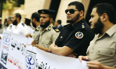 Egyptian police officers protesting over beards.