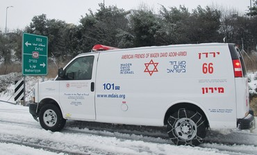Ambulance in slush-covered streets of Safed
