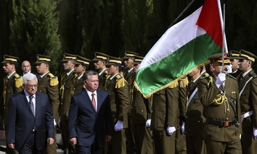 Abdullah, Abbas walk in West Bank, Dec. 6, 2012