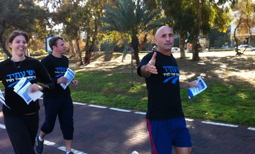 Yesh Atid candidates running through TA's park Hayarkon