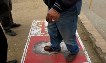 Egyptian man steps on poster of President Mohamed Morsi in Cairo