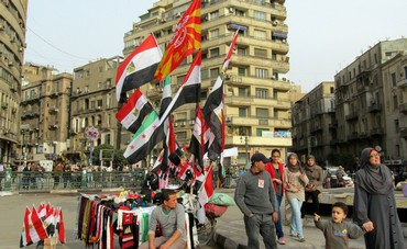 A vendor sells flags in Tahrir Square, January 25, 2013  of President Mohamed Morsi in Cairo