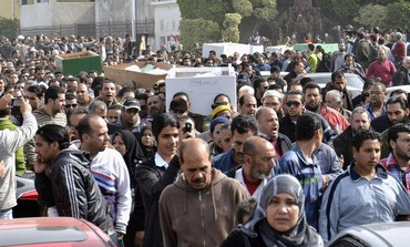 Mourners attend the funerals of 33 people who died in Port Said protests, January 27, 2013.
