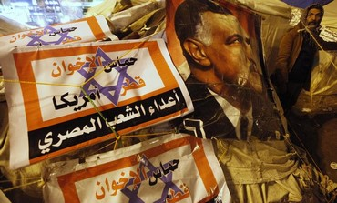 Protest signs in Tahrir square, January 31, 2013.