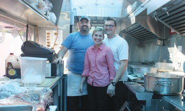Matthew Haney, and Emily and Michael Israel in their Moe Deli food truck.