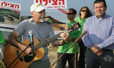 ENVIRONMENTAL ACTIVISTS, led by Green Party head Alon Tal, hold a protest along the Palmahim Beach