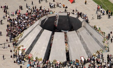 ARMENIANS VISIT a memorial to the Armenian Genocide in Yerevan