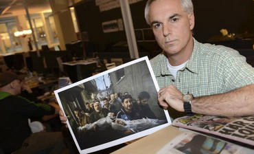 Paul Hansen of Sweden, poses holding his picture that won the World Press Photo of the year for 2012