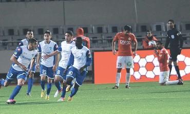 IRONI KIRYAT SHMONA players celebrate goal