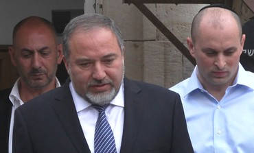 Avigdor Liberman leaving court after first hearing in corruption trial, February 17, 2013.