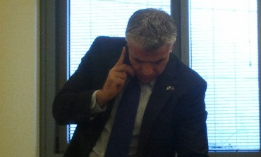 Yesh Atid leader Yair Lapid talking to Jonathan Pollard on the phone, February 18, 2013.
