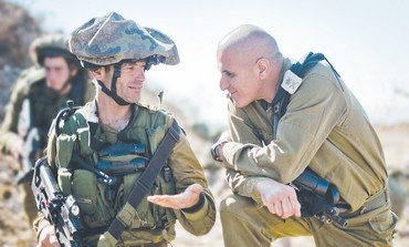 MAJ.-GEN. SAMI TURGEMAN speaks with a soldier