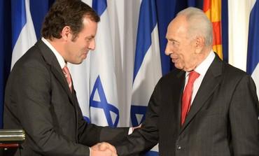 President Shimon Peres and Barcelona FC President Sandro Rosell.