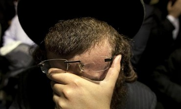 An Orthodox man weeps